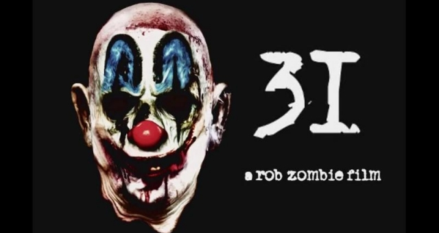 "31 is a ""...morbid, energetic grindhouse thrill ride with plenty of chainsaws, boobs, and Hitler midgets."" Check out our full thoughts on the latest Rob Zombie directed horror now!"